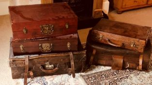 An early 20th Century Dutch leather suitcase; others similar. (5)
