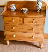 A Victorian style pine washstand chest, three quarter scrolling gallery, moulded front top, above