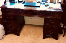 A Victorian Revival mahogany twin pedestal desk, slight oversailing moulded edge fitted with green