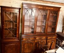A 20th century mahogany bookcase, dental cornice above three glazed doors with Gothic style