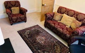 A 20th Century two seater drop end sofa; a similar armchair and rug (3)