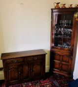 A 20th century oak sideboard; a similar corner cupboard. (2)