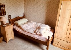 A 20th Century pine single bedroom suite, single bed, bedside cabinet and wardrobes. (3)
