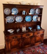 A George III revival oak dresser, moulded cornice over open two shelves, slight oversailing top