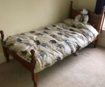 A recent single pine bed. 110cm H x 203cm W x 102cm D