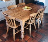 A 20th Century pine kitchen table and six chairs on turned supports (7) table: 77cm H x 168cm W x