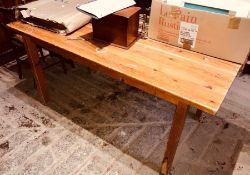 A 20th Century pine grained kitchen table 76cm H x 152cm W x 77cm D