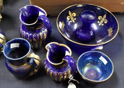Blue lustre 19th Century water jugs along with other blue and gold graduated water jugs, glass