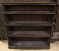 A 19th Century waterfall bookcase, fitted with four shelves, 118cm high, 110cm wide, 26cm deep