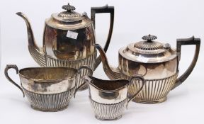 An early 20th Century Georgian style plated four piece tea and coffee set, gadroon lower sections (