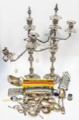 A pair of 19th Century three light candelabra, detachable arms with flame terminal stoppers, the