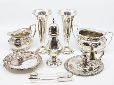 A group of silver plate to include: 19th Century chamber stick and snuffer; pair of trumpet shaped