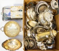 A collection of silver plated items including food trays, bowls, wine coasters, engraved teapots,
