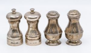 A pair of George V larger pear shaped silver pepper pots, London, circa 1918, 6.90 ozt, marks rubbed