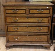 A George III oak and mahogany cross-banded chest of drawers, circa 1790, comprising two short over