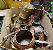 A collection of brass and copper wares, 18/19/20th Century, cooking pots, hot water kettles,