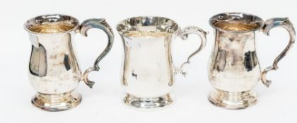 An Elizabeth II plain silver mug, with scroll handle acanthus thumbpiece, engraved with monogram, by