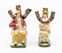 A pair of Staffordshire pearl ware figures of an old man and a lady holding a sheep ***