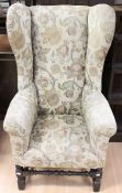 A Victorian 'Carolean' style wing chair, pegged mortise and tenon construction, upholstered in