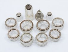 Four pairs of early 20th Century hobnail and cut glass circular salts with silver collars, various