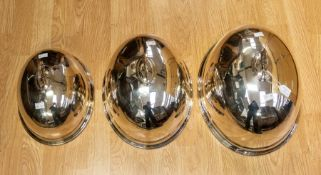 A set of three silver plated graduating meat / food dish covers by Walker & Hall of Sheffield silver