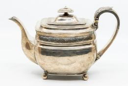 A George III Provincial large silver teapot oblong shaped with bright cut engraved decoration, the