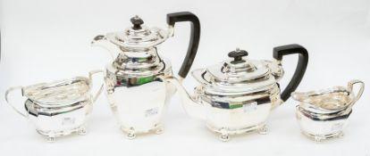 A George V silver matched four piece tea service comprising teapot, sugar bowl, milk jug and hot