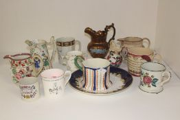 A collection of 19th Century early to late Staffordshire pottery jugs including frog, mugs and other
