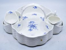 A collection of ceramics to include: three sets of Royal Worcester gilt chocolate cups and covers (2