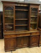 An early Victorian oak glaze topped dresser, circa 1850, the upper section with two glazed doors
