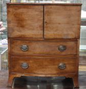 An early to mid 19th Century mahogany pot cupboard, comprising two doors over two drawers, raised on