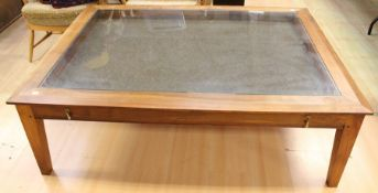 A contemporary rosewood display table, fitted with a single drawer, raised on square legs, 45cm