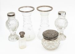 A collection of silver topped glass vases, two pairs, powder pot, perfume bottle, all silver