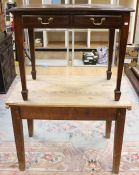 A late 19th Century joined pine topped kitchen table, raised on square legs, together with an