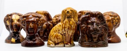 A collection of stone ware sash window stoppers in the shape of ladies and lions heads ***