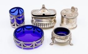 A collection of silver condiments to include: Georgian style large drum shaped mustard pot and