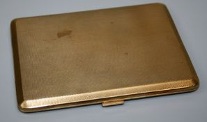 An early 20th century heavily made 9ct yellow gold rectangular cigarette case with engine turned