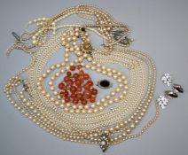 A freshwater pearl collar together with other cultured and pearl necklaces, some requiring re