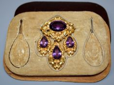 An early 19th Irish yellow metal and amethyst brooch of lozenge form with three corresponding