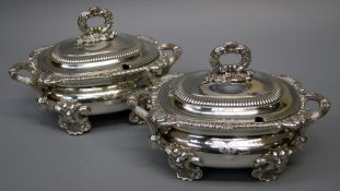 A pair of important Regency silver sauce tureens and covers, each with shell feet and reeded