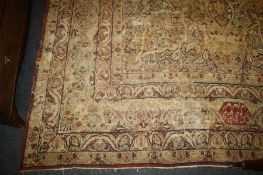 An early 20th century finely woven Kirman carpet of Polylobate design on an ivory ground typically