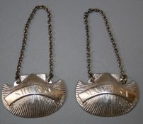 """A pair of Irish silver """"Dublin-Shell"""" decanter labels bearing the legends """"Sherry"""" and """" Madeira"""""""