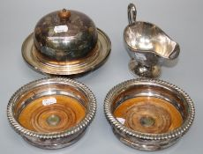 A pair of Victorian silver plated circular wine coasters with hardwood bases. Together with a