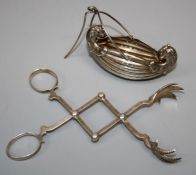 """A pair of Gorham & Co, American silver """"concertina"""" sugar tongs with eagle claw detail. Together"""