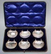 Hilliard and Thomason, a cased set of six silver lemon tea coasters, Birmingham 1904. One with