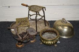 A 19th century Dutch brass jardinière with lion's mask ring handles and paw feet, together with