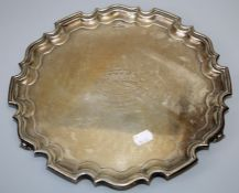 Walker and Hall, a mid 20th century silver salver, with presentation inscription and pie crust rim
