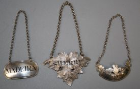 A Victorian cast silver vine leaf, sherry decanter label. London 1845 by Reily & Storer. Together