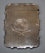 A Victorian silver cartouch form calling card case with engine turned and elaborate armorial crest