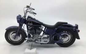 Franklin Mint: A boxed Harley Davidson Blues Missile by Franklin Mint. Boxed with papers and tag.